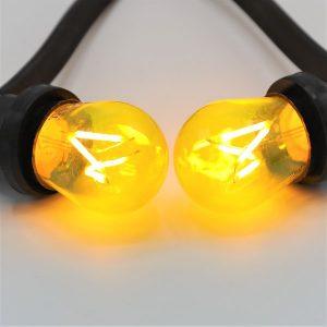 Gele dimbare filament lamp voor guirlande of prikkabel
